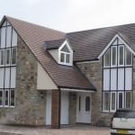 Specialist angled windows in white upvc Sandbay