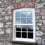 White uPVC sash window installation in Wells