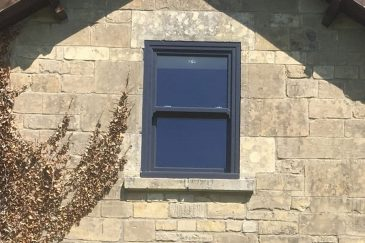 A single anthracite grey uPVC sliding sash window
