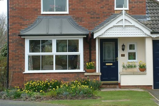 White uPVC bay window and composite door