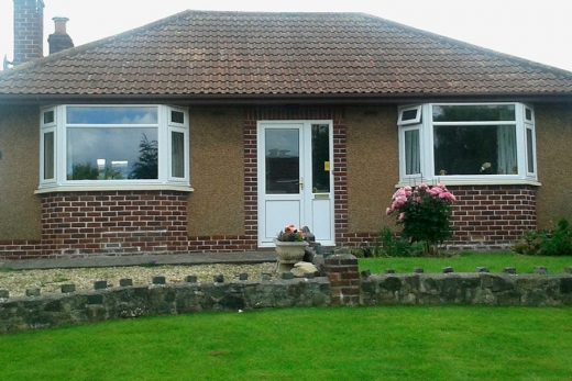 Dual white uPVC bay windows installation
