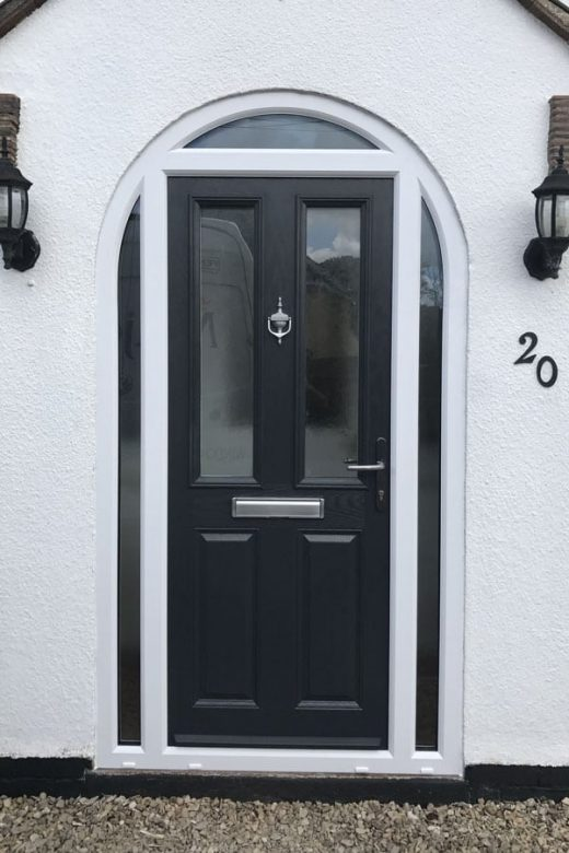 Black composite door with a white frame