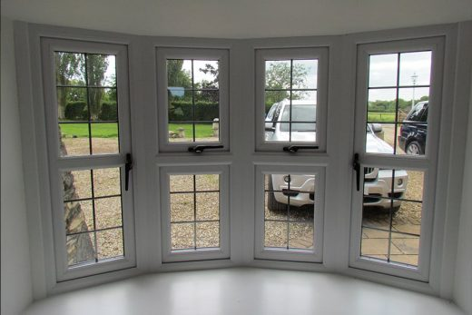 Interior view of a uPVC bow window with leaded glazing
