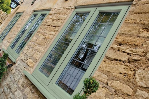 Chartwell green uPVC casement window with leaded glazing
