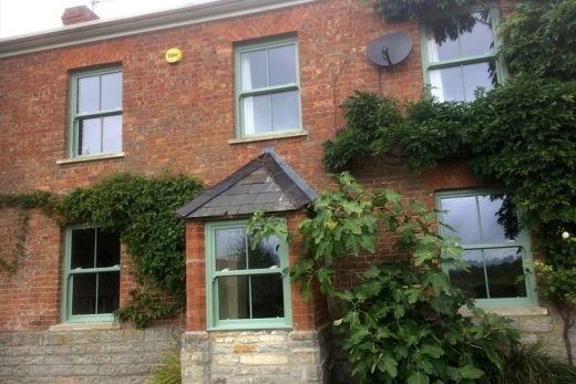 Chartwell green uPVC sliding sash windows