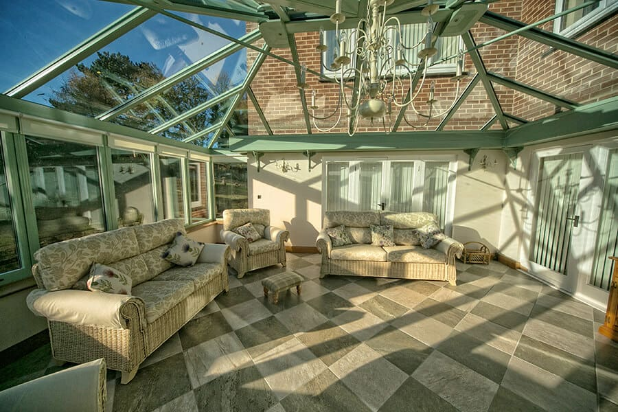 Interior view of a bespoke chartwell green uPVC conservatory