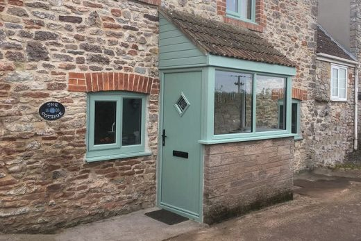 Chartwell green composite door and entrance porch