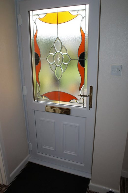 White uPVC entrance door with stained glass