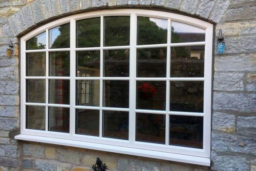 Cream uPVC bespoke curved window