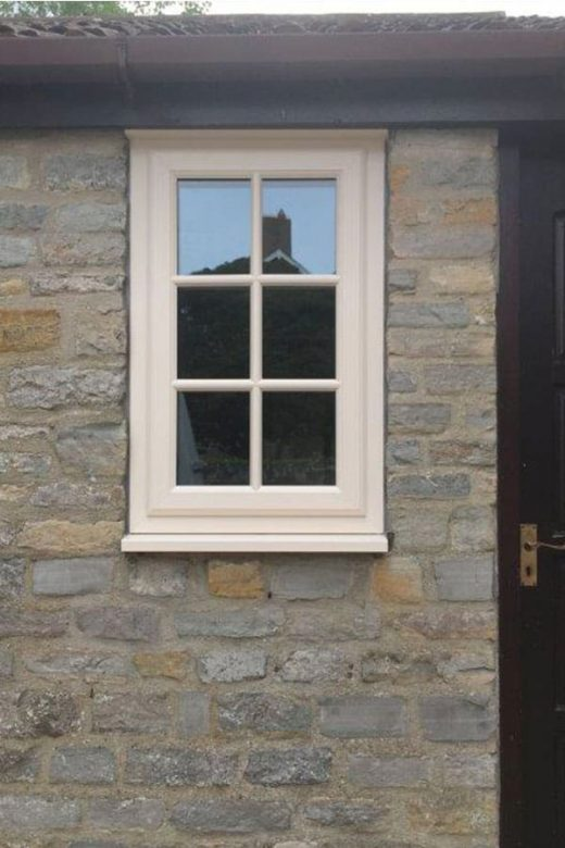 A single cream Georgian uPVC casement window