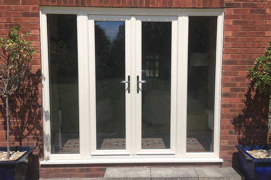 Cream uPVC french door with side windows