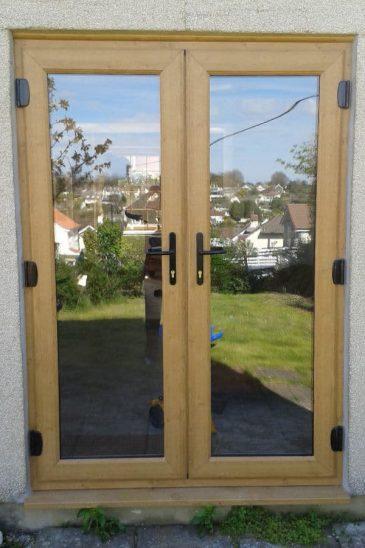 Close up of an Irish oak effect uPVC french door