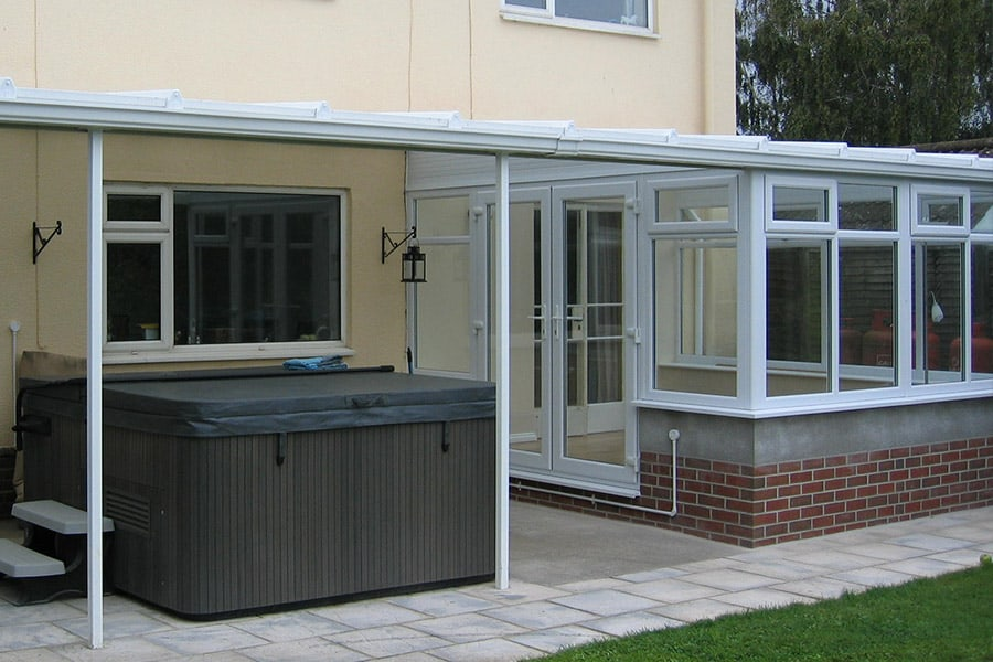 White uPVC lean to conservatory with a veranda