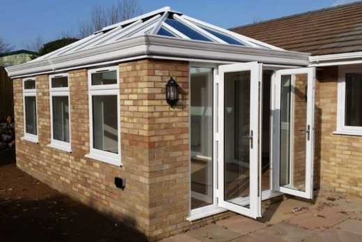White uPVC LivinRoom with open french doors
