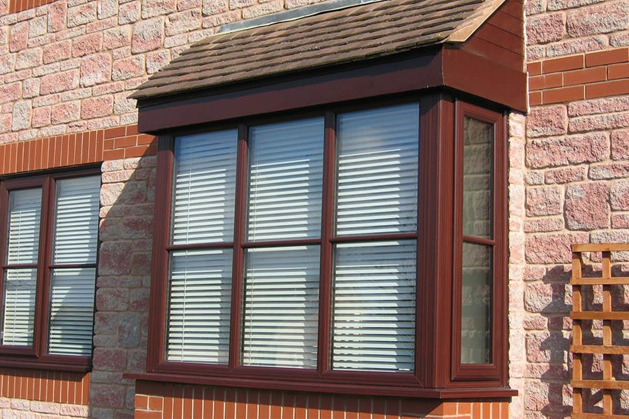 Rosewood effect uPVC bay window