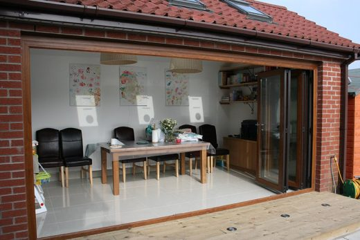 An open coloured uPVC bifold door