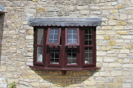 Rosewood uPVC bow window with leaded glazing