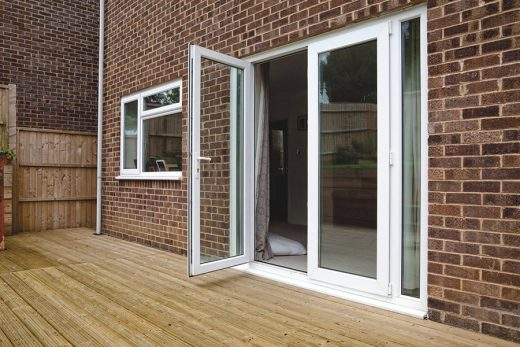 An open white uPVC french door