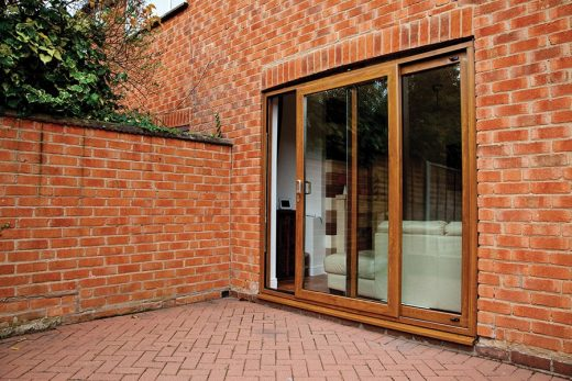 An open golden oak effect uPVC patio door