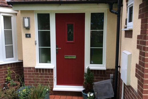 Red composite door with a white frame
