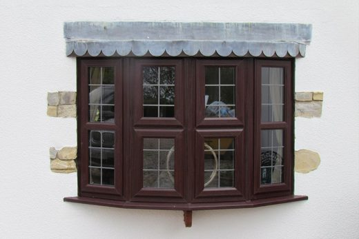 Rosewood effect uPVC bow window