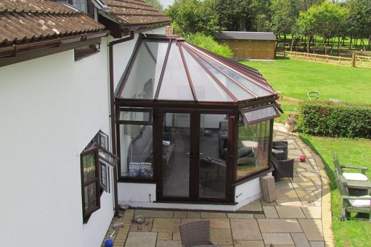Rosewood effect uPVC victorian conservatory