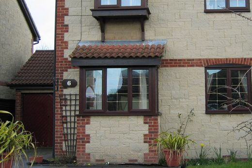 Rosewood uPVC bay windows with leaded glazing