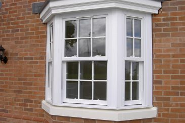 White uPVC sliding sash bow window