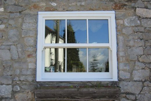 A single white uPVC sliding sash window