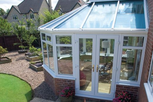 Side view of a white uPVC victorian conservatory