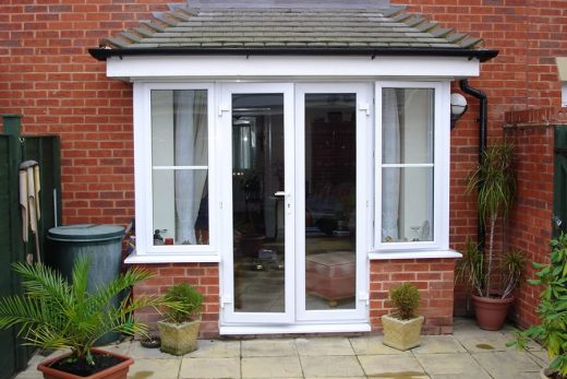 White uPVC french doors with side windows