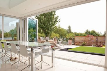 An open white uPVC bifold door