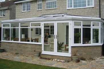 A large white uPVC victorian conservatory