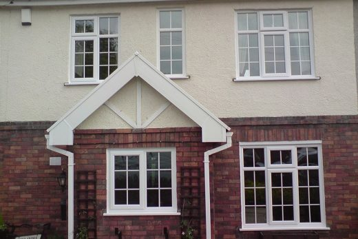 White uPVC casement windows with bars