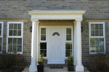 White uPVC entrance door with side windows