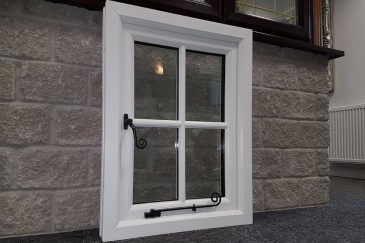 Majestic Designs showroom white uPVC window with monkey tail handles