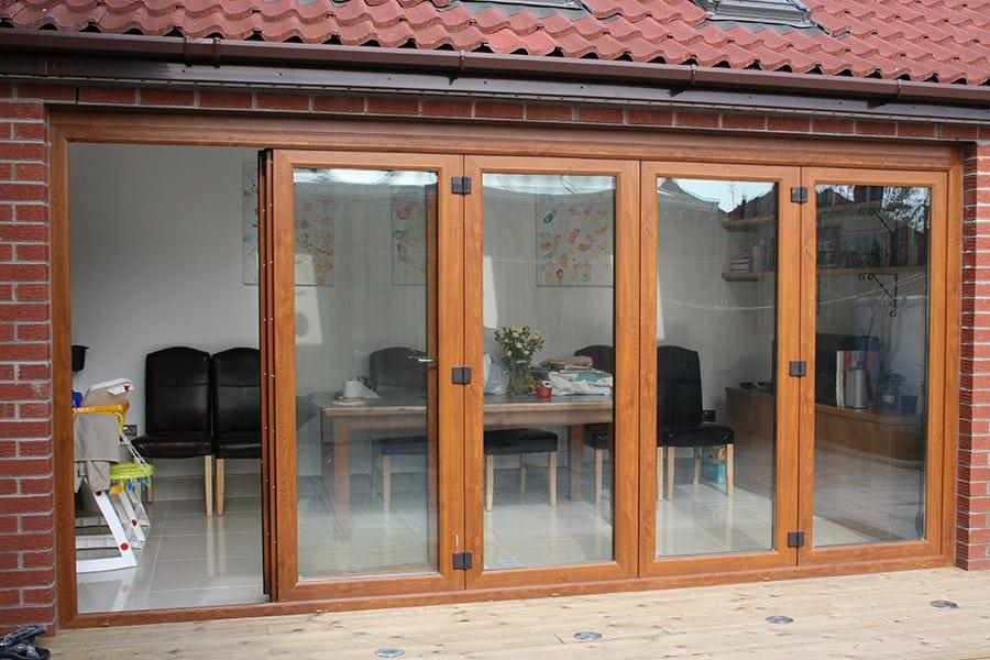 Golden oak effect uPVC bifold door