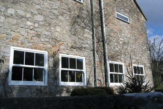 Small white uPVC sliding sash windows