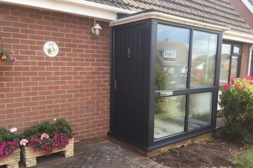 Black uPVC entrance door and porch