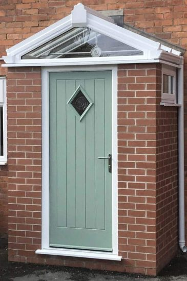 Red brock porch with chartwell green composite door
