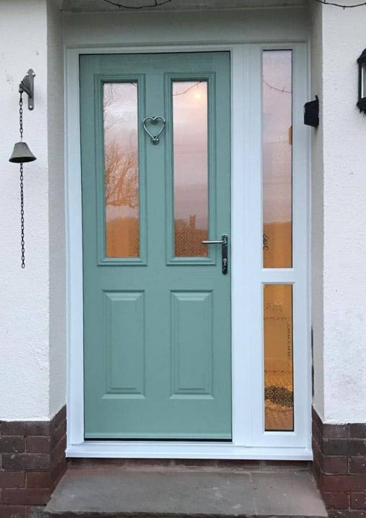 Chartwell green composite door with a white side panel